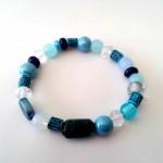 "Blue Light - € 8,95<a href=""/product/blue-light"" target=""_blank"">BESTELLEN</a><br>Armband met glasparels, crystalkralen, keramiekkralen, acrylkralen, elastisch koord - 16 cm"